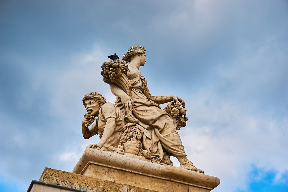 Experience the ornate statues surrounding the palace